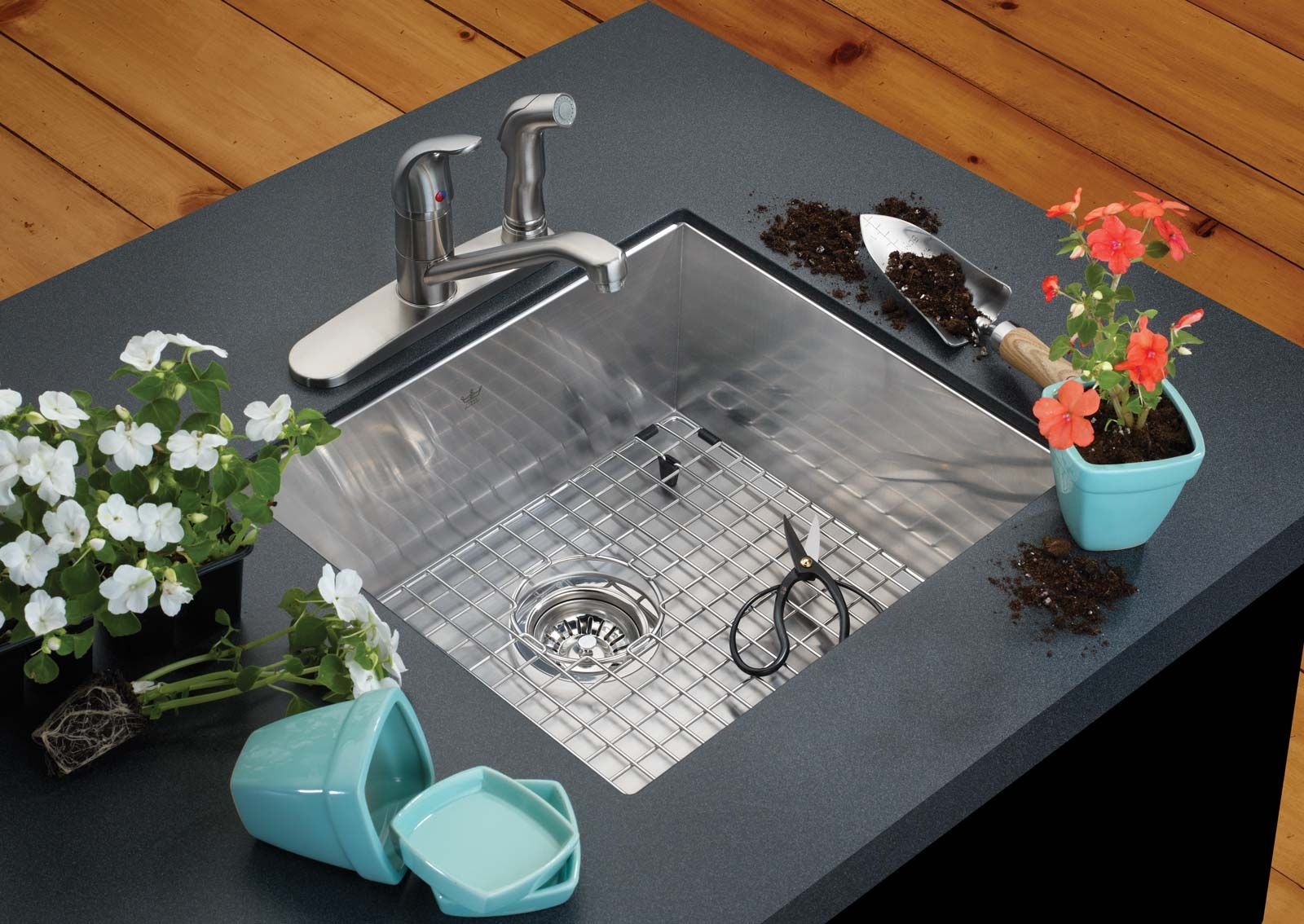 installed steel sink with metal grill